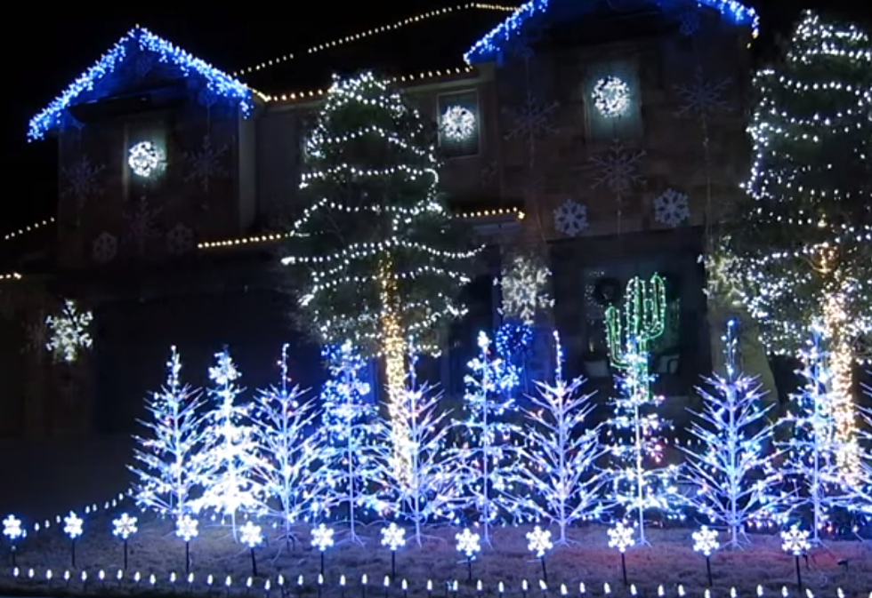 house with synchronized christmas light show to let it go from frozen soundtrack video