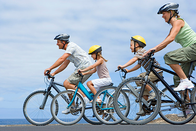 Family riding bikes together